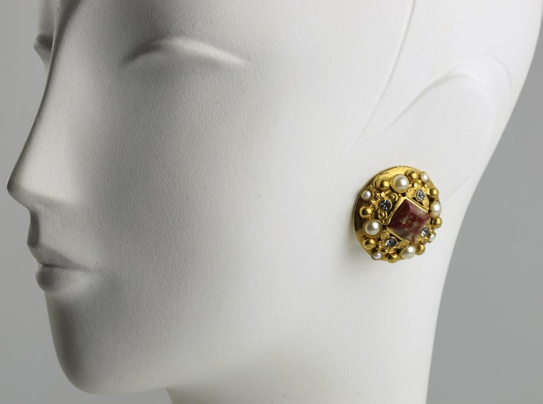 French Jewelry designer Henry Perichon (aka Henry) signed clip-on earrings. Gilt metal rounded shape in a Baroque design inspiration ornate with pearl-like, square burgundy gemstone and crystal clear rhinestones. Signed