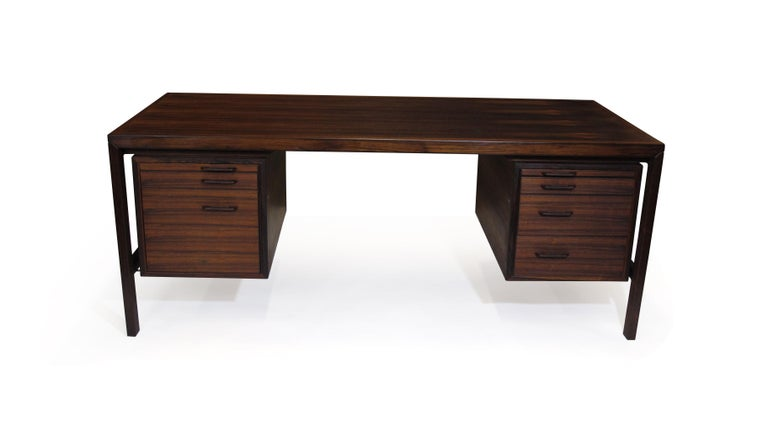 Brazilian rosewood executive desk designed by Danish designer Henry Rosengren Hasnsen for Brande Mobelindustri, Model 52, circa 1965 Denmark. The desk is handcrafted of fine Brazilian rosewood, and features two bank of drawers on left and right,