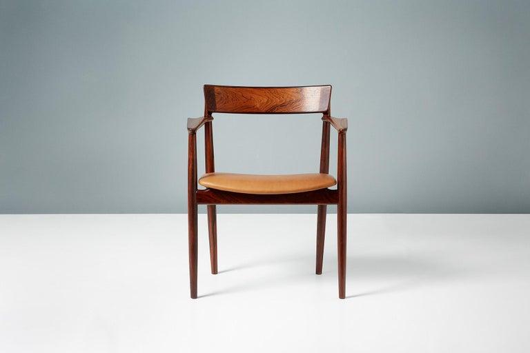 Henry Rosengren Hansen  Armchair, 1960  Angular, sculpted armchair from Henry Rosengren Hansen produced by Brande Mobelfabrik in Denmark using exceptional quality Brazilian rosewood. The seat has been reupholstered in tan aniline leather.