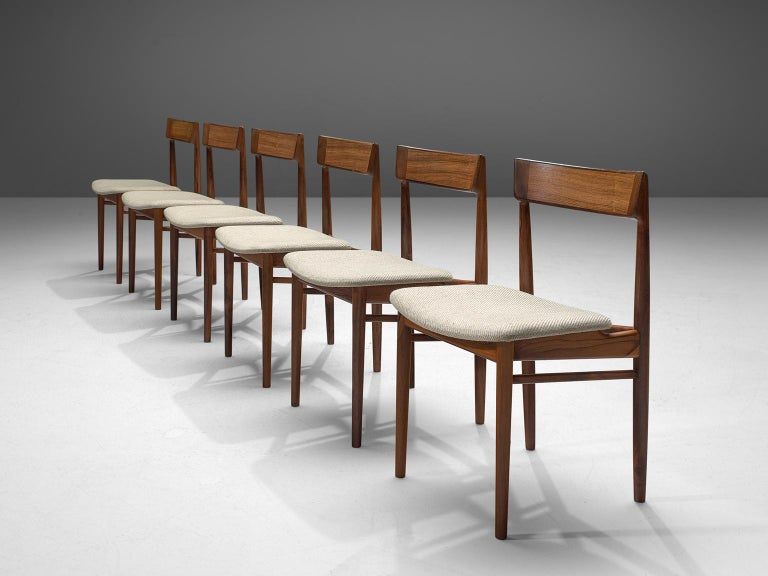 Henry Rosengren Hansen, dining chairs model 39, rosewood and fabric, Denmark, 1960s.  This wonderful crafted set of six dining chairs feature a solid rosewood frame. Danish designer Rosengren Hansen is known for high quality and very refined