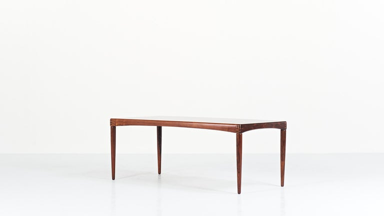Rare coffee table in rosewood veneer and solid rosewood, by the Norwegian designer Henry Walter Klein for Bramin. Superb finishes. Labeled and dated July 5, 1968. Very slight traces of use, very good condition.
