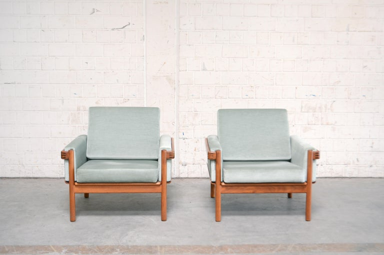 Danish modern armchair by Henry Walter Klein for Bramin. The frame is made of solid teak wood with some nice details. The cushions are renewed some years ago in velour fabric pastel color. Set of 2.