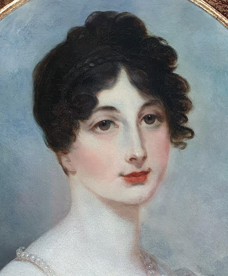 Portrait of a Lady in a White Dress with Pearl Jewellery Follower of Henry Whatt  In this enchanting portrait a young lady has been depicted wearing fashionable clothing from circa 1805.  The simple white satin dress with the gathered fabric at the