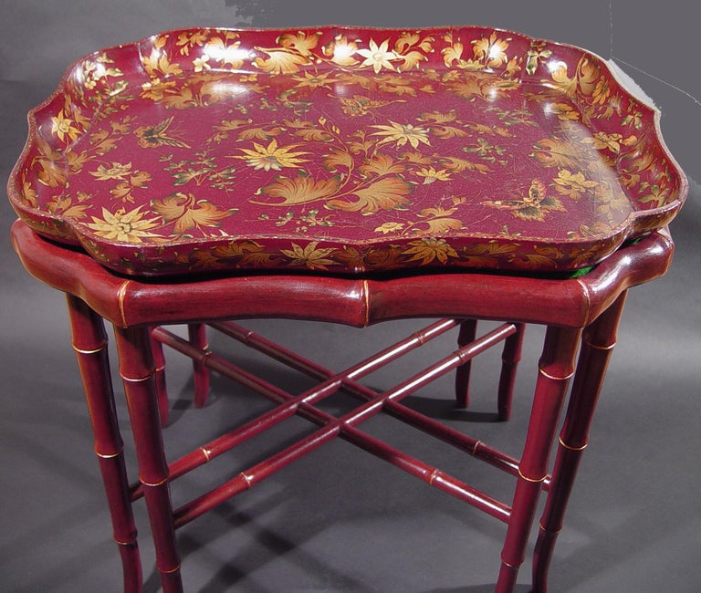 Burgundy papier mâché lacquered tray and base, Impressed Clay for Henry Clay, circa 1815  The burgundy-ground papier mâché lacquered tray is decorated with colored and gilt leaves and butterflies. The tray rests on a contemporary double legged