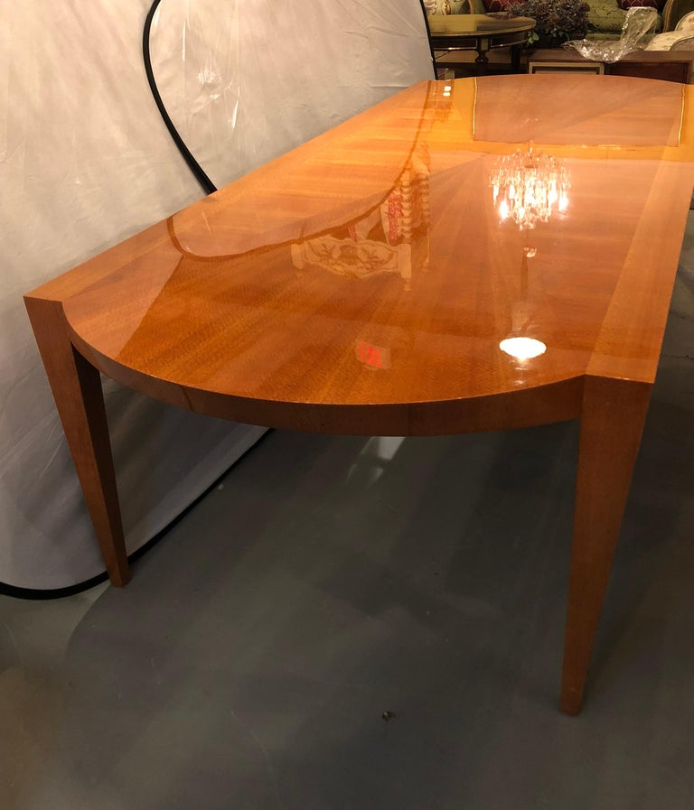 Mid-Century Modern style Heraldic Dakota Jackson Australian Lacewood dining or conference table. Arched aprons and tapered trapezoidal legs. This table is in very nice condition with a fine sunburst top. The owner having paid in excess of $25,000 to