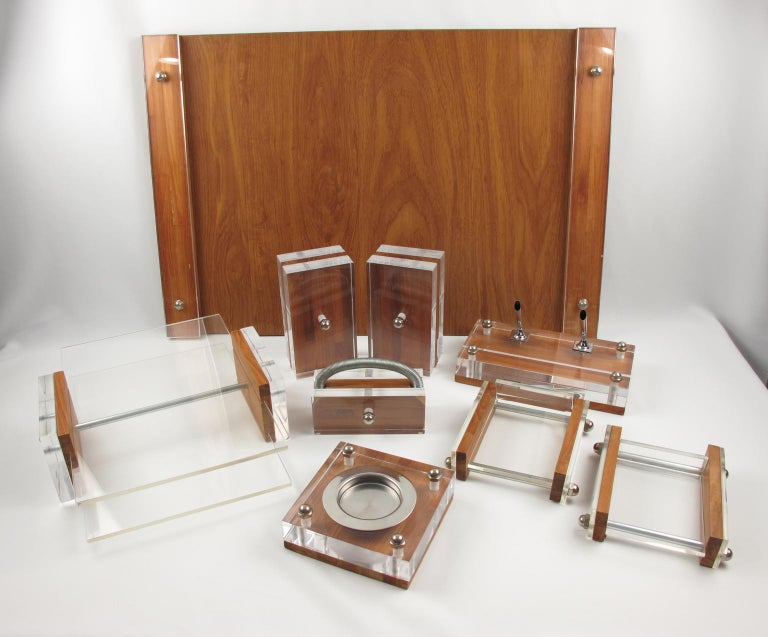 Stunning Mid-Century Modernist desk set accessories designed by Herbert Ritts for Ritts Co, Los Angeles, CA, part of the Astrolite collection. Rare desk set with nine pieces: pen holder, ashtray, pair of bookends, mail holder, letter holder, pair of