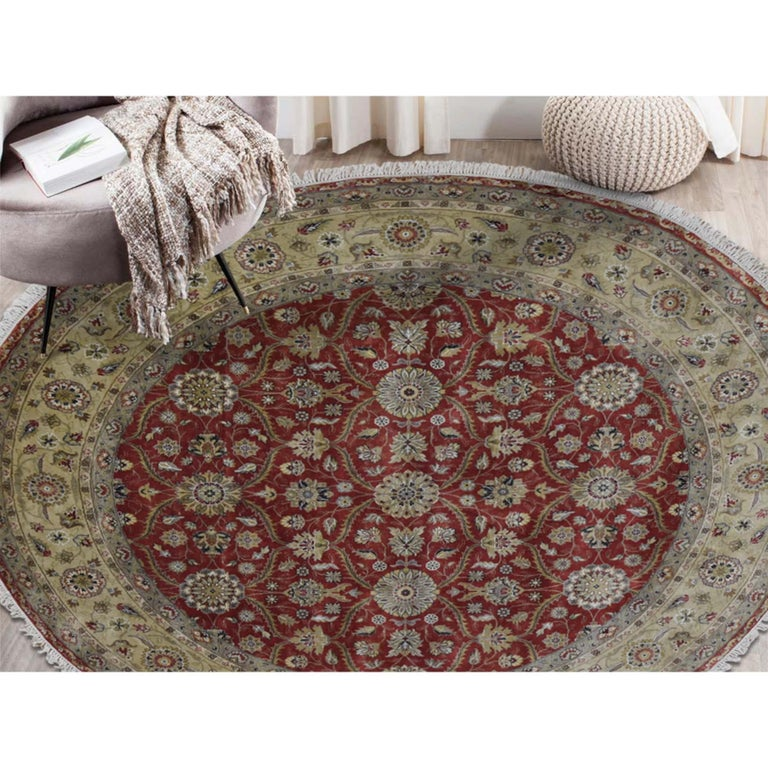 This is a truly genuine one-of-a-kind Hereke design wool and silk hand knotted 300 Kpsi round Oriental rug. It has been knotted for months and months in the centuries-old Persian weaving craftsmanship techniques by expert artisans. Measures: 8'1
