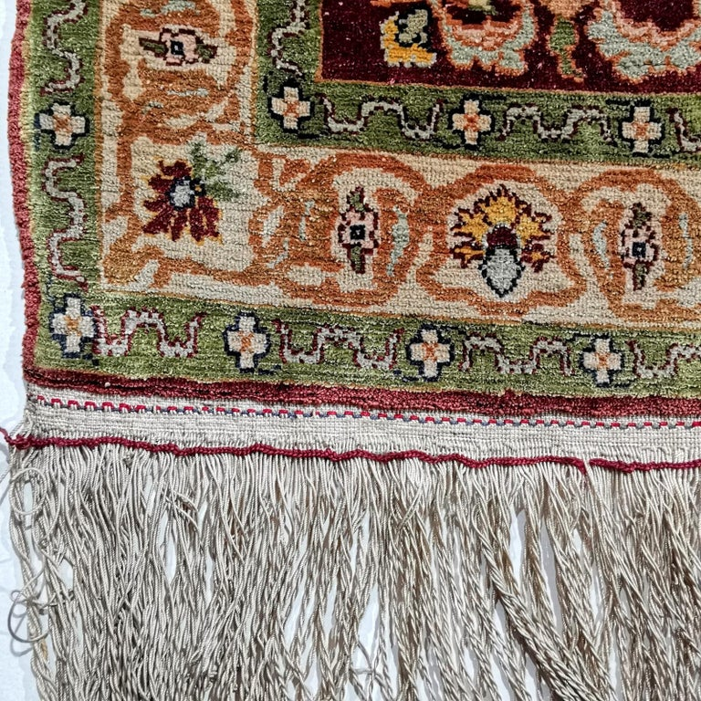 Very fine Turkish pure silk Hereke prayer rug.   Turkish Hereke Souf silk rugs are the most exclusive and highly priced rugs of all silk rugs made. The raw material is exquisite original Bursa silk made from Mulberry silk worms, dyed with