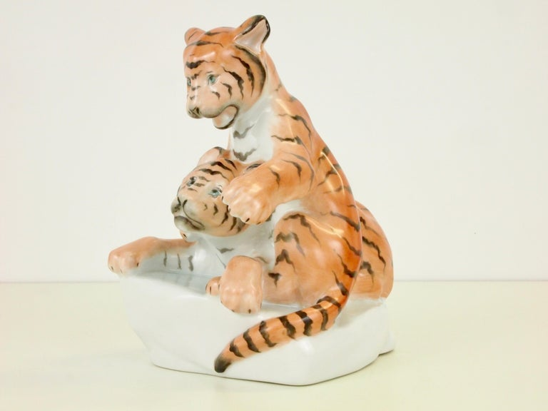 Vintage midcentury porcelain figurine by Herend depicting a couple young tiger cubs playing joyfully together.