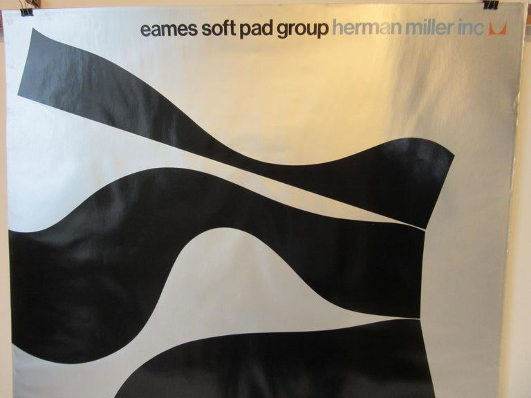 A Herman Miller dealer display poster with silver and black lithograph mod design for the Soft Pad Group chair sets. A rare and hard to find poster with text to the top and the Miller icon in orange and turquoise with black floating seat forms on a