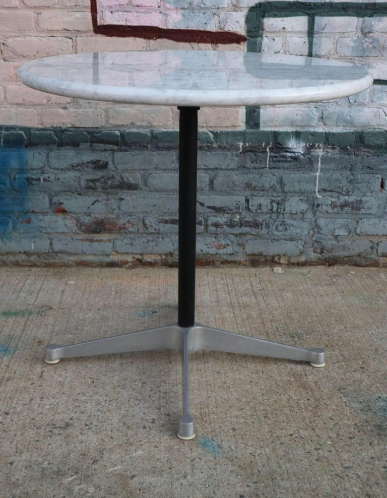 Gorgeous cafe sized dining table. Herman Miller Eames aluminum group base with new custom cut Carrara marble 30 inch top. Full bullnose rounded edge. Heavy and sturdy. Perfect for smaller spaces like a breakfast nook, porch, or apartment. This is a