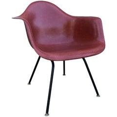 Herman Miller Eames armchair in Terracotta