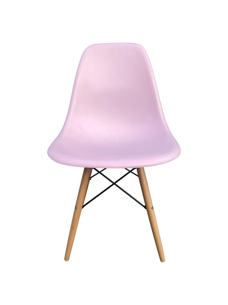 Set of vintage Herman Miller Eames shell chairs recoated in pink. Add a little fun and pop of color to your breakfast nook. Shells signed and guaranteed authentic Herman Miller production. New wooden dowe bases offer a clean fresh look.