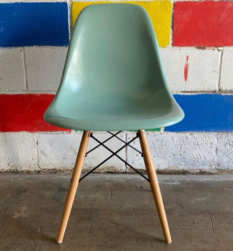 Set of 4 Herman Miller Eames dining chairs recoated in seafoam green. Authentic signed shells sit atop new wooden dowel bases. No cracks to the chairs.