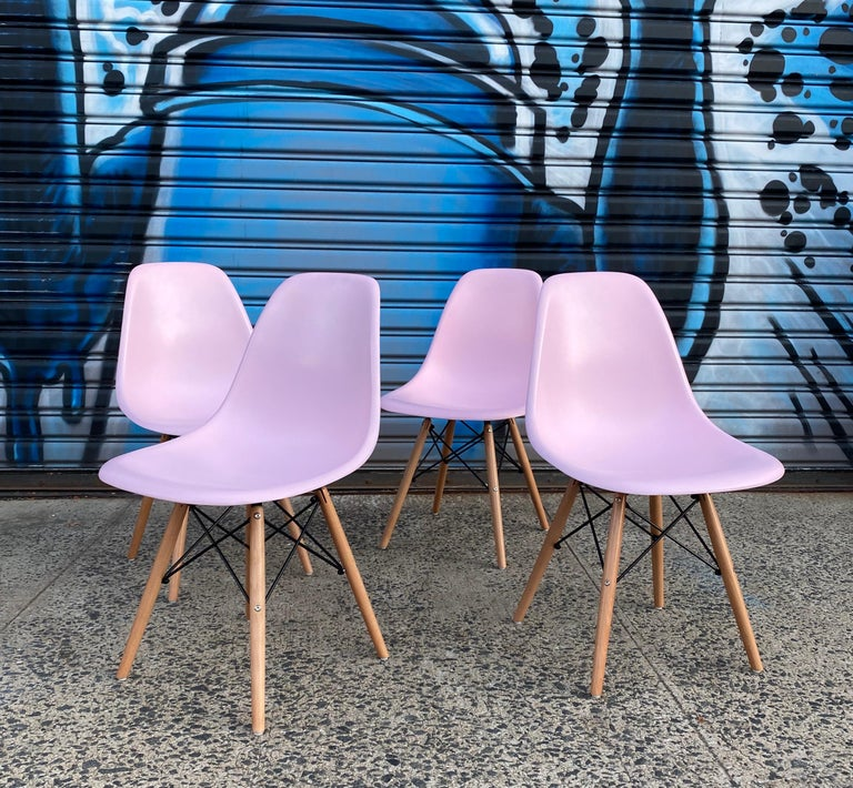 Vintage Herman Miller Eames shell chairs on new wood bases. Shells date to the 1970s. Since this color was not offered as an original couple we had these custom recoated and result speaks for itself. Chairs have freshly applied brand new rubber
