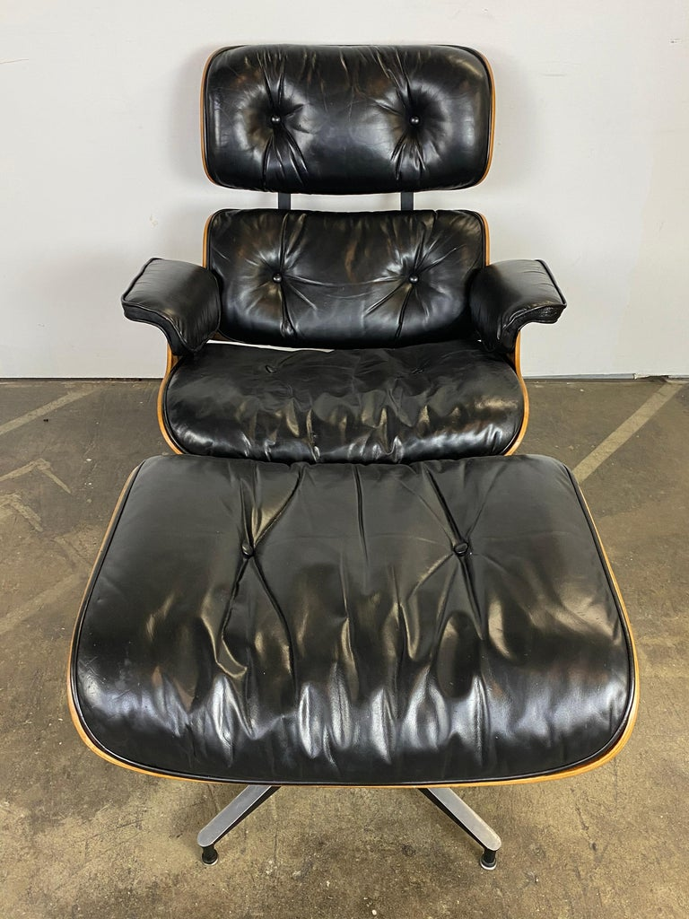 Handsome and elegant example of the modernist design Classic. This Eames lounge chair features spectacular Brazilian wood shells and black leather. The wood has been recently oiled (per Herman Miller recommendation) and displays its beautiful color