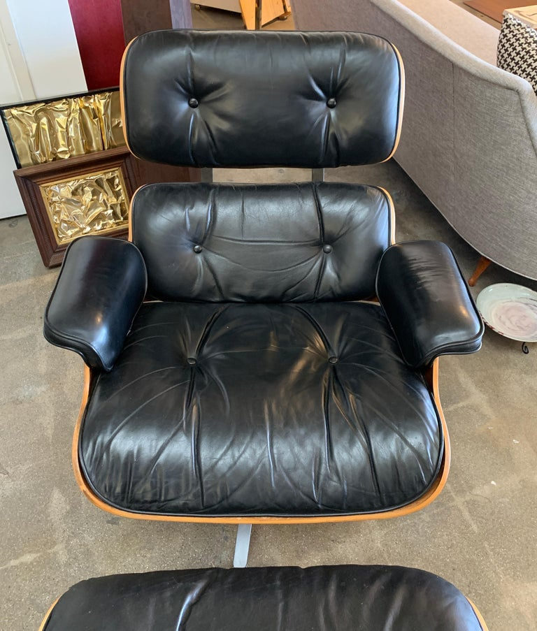 A 2006 labeled Eames lounge chair and ottoman by Herman Miller. Both pieces have Herman Miller tags and the chair has a Hume Modern Tag as well.This is the tall version at 33.5 inches tall at the back. It has presumably been restored at some point.