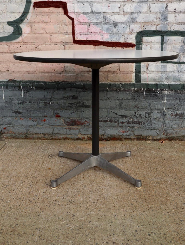 1970s era Herman Miller Eames circular dining table. Measures: 36 inches in diameter. Fits up to 4 chairs.