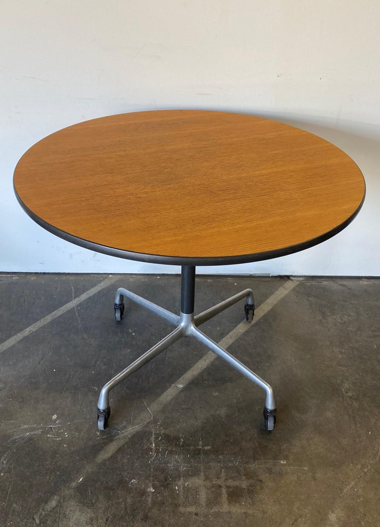 Beautiful dining table design by Charles Andrew Eames and produced by Herman Miller. 36 inches in diameter accommodates up to four dining chairs. Moves freely and easily on original casters. They are rubber for use on a variety of surfaces. Table is