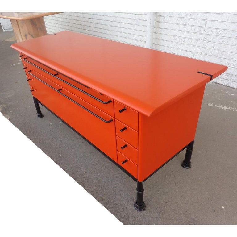 Herman Miller Geoff Hollington Relay Series credenza  Recently restored in bright orange this classic credenza from the Relay series has multiple drawers and a pullout work surface.   8 shoebox drawers 2 large drawers Pull-out work