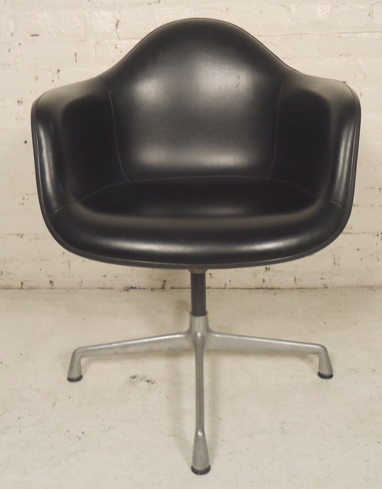 Classic Mid-Century Modern office chair on swivel base in black leather. Molded fiberglass seat with arms on aluminum base.  (Please confirm item location - NY or NJ - with dealer).