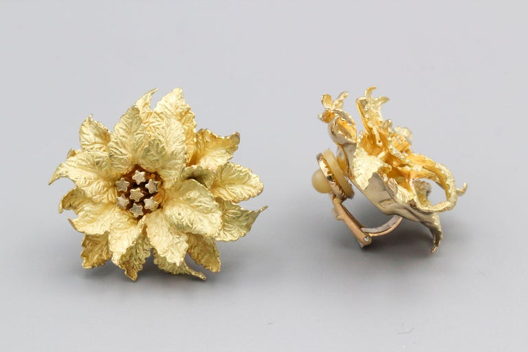 Fine 18K yellow gold earrings by Hermes. They resemble flowers with several small stars coming out of the middle. Circa 1970s.  Hallmarks: Hermes Paris, French 18K gold assay mark.