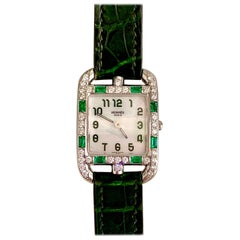 Hermès 18 Karat White Gold Quartz Watch with Emerald and Diamond Surround