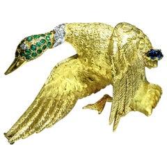 Hermes 18 Karat Yellow Gold Emerald Sapphire and Diamond Bird Brooch