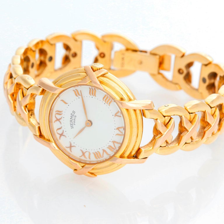 Hermes 18K Yellow Gold Ruban Ladies Watch  - Quartz. 18K Yellow gold ( 26 mm ) . White dial with Roman numerals . 18K yellow gold link bracelet . Pre-owned with custom box .