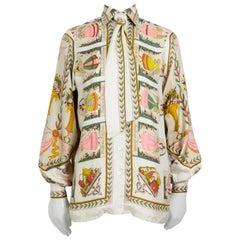 """Hermes 1970s silk """"huile rafraichissante de la toilette parfume"""" print blouse"""