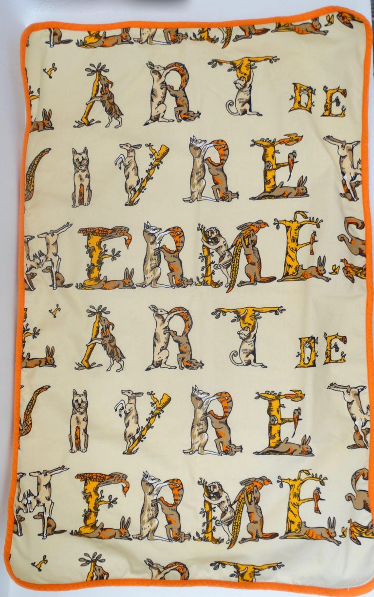 Keep your kitchen looking fabulous with this Hermés towel! Circa 1990s, this decorative towel is made of cotton and features various woodland creatures that are positioned to spell out