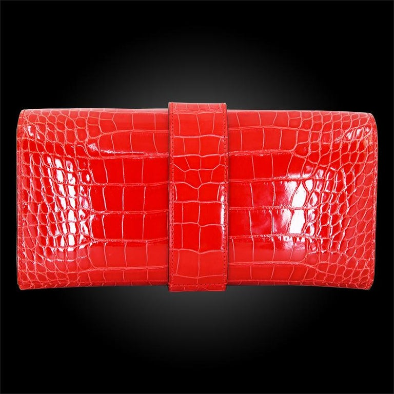 100% Authentic Mississippiensis Lisse Hermes Clutch Bag  COLOR: Red MATERIAL: Alligator ORIGIN: France CONDITION: Pristine
