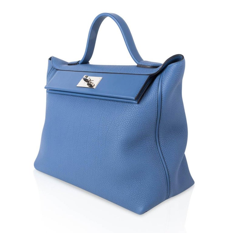 Guaranteed authentic Hermes 24/24 35 bag features Blue Brighton and palladium hardware. The 35 cm is the most rare size to find in the 24/24.  Togo leather with Swift leather accent panel. Comes with signature Hermes box and sleepers.  NEW or NEVER