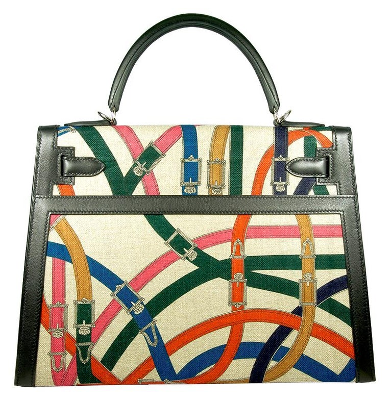 HERMES 32cm Limited Edition Retourne Kelly Bag with Black and Multicolor tones.  This Hermés bag embodies the quintessence of style and luxury due to its impeccable design, craftsmanship, rarity and significance. As the most one of the most iconic