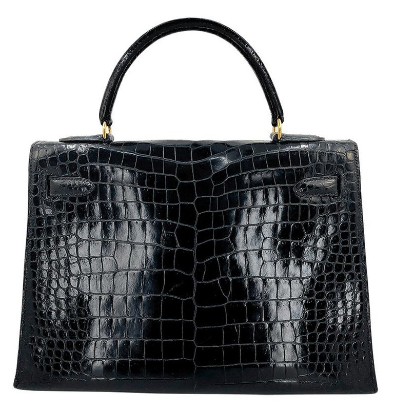 100% Authentic Hermes 35cm Brown Crocodile Birkin Bag  COLOR: Brown MATERIAL: Crocodile ORIGIN: France CONDITION: Pristine