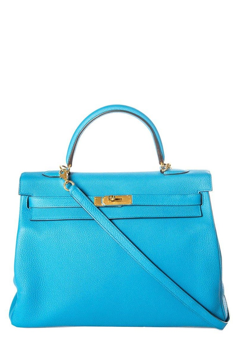 Hermes Clemence Izmir Kelly 35cm with gold-plated hardware, single rolled top handle, detachable flat shoulder strap, protective feet at base, tonal leather interior, three interior pockets; one with zip closure and turn-lock closure at front flap.