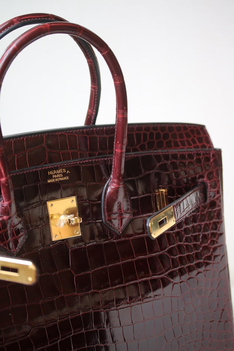 Hermès Burgundy Smooth Porosus Crocodile 35 cm Birkin Bag with Gold Hardware. The most fabulous of all bags can be yours today! Luxuriously rich coloured with tonal top stitching. This Birkin is in excellent condition. Only lightly used. Has been