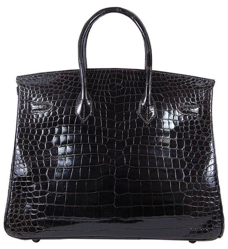 HERMES 35cm Cacao Shiny Porosus Birkin Bag with Silver Hardware 100% Authentic Hermes Birkin Bag MATERIAL: Crocodile HARDWARE: Silver ORIGIN: France INCLUDES: Dustbag, lock, and key