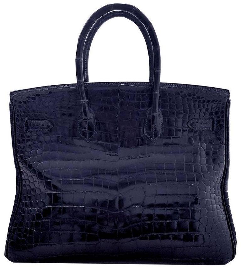 HERMES 35cm Dark Blue Birkin Crocodile Bag with Silver Hardware 100% Authentic Hermes Birkin Bag MATERIAL: Crocodile HARDWARE: Silver ORIGIN: France INCLUDES: Dustbag, lock, and key