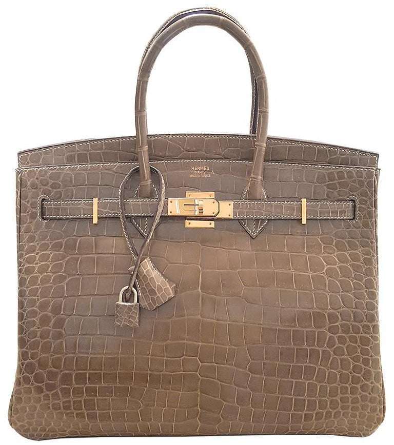 HERMES 35cm Poussiere Porosus Birkin Crocodile Bag with Gold Hardware 100% Authentic Hermes Birkin Bag COLOR:  MATERIAL: Crocodile HARDWARE: Gold ORIGIN: France INCLUDES: Dustbag, lock, and key
