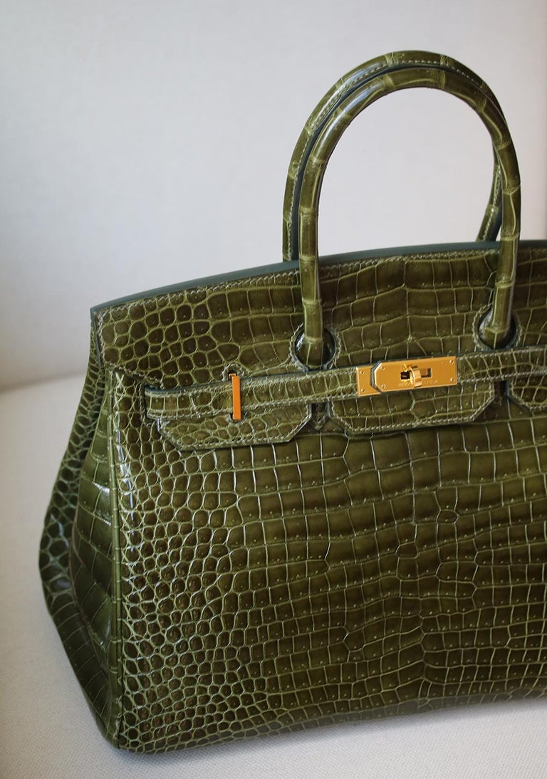 Hermès Vert Smooth Porosus Crocodile 35 cm Birkin Bag with Gold Hardware. The most fabulous of all bags can be yours today! Luxuriously rich coloured with tonal top stitching. This Birkin is in excellent condition. Only lightly used. Has been