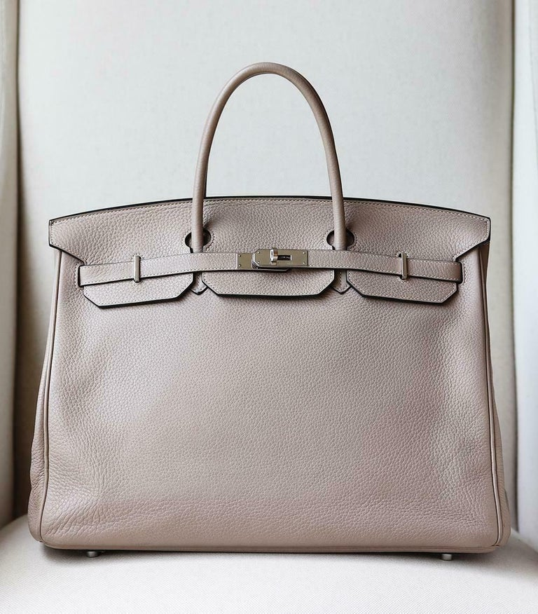 Hermès 40cm Clemence Birkin Bag with Palladium hardware. Top handle straps. Tonal leather lining. Double slit pocket and zip pocket on interior walls. Turn-lock closure at front.  Colour: Gris (light stone-grey) Does not come with dustbag, lock,