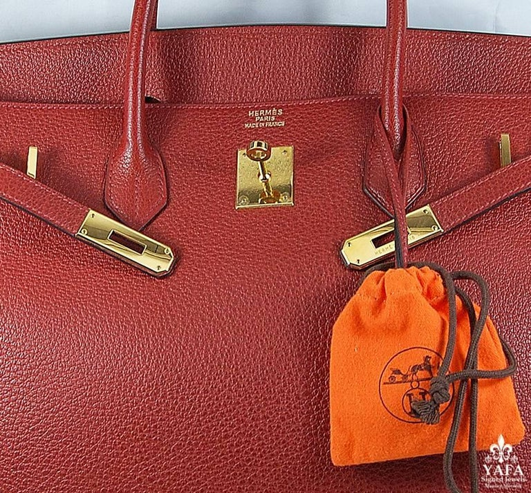HERMES 40cm Red Birkin Bag with Gold Hardware 100% Authentic Hermes Birkin Bag COLOR: Red MATERIAL: Leather HARDWARE: Gold ORIGIN: France CONDITION: Good Includes: Dustbag, lock, and key