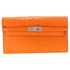 Hermès Abricot Matte Alligator Classic Kelly Wallet PHW