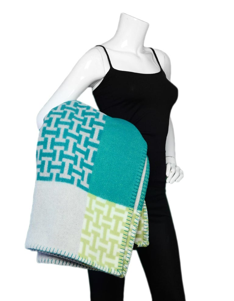 Hermes Aloe Vera Green Avalon Terre d'H Wool & Cashmere Throw Blanket  Made In: Great Britain Color: Green, grey Materials: 90% wool, 10% cashmere Overall Condition: New Estimated Retail: $1,600 + tax **Please note that this item was purchased at an