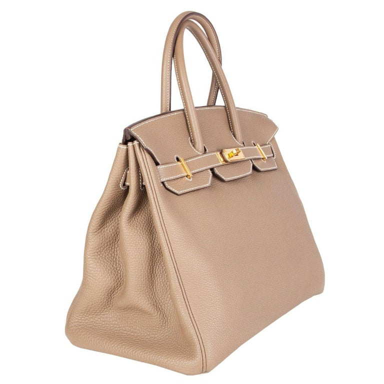 Hermès 'Birkin 35' bag in Argile (light taupe) Taurillone Clemence leather with gold-plated hardware. Lined in Chevre (goat skin) with an open pocket against the front and a zipper pocket against the back. Has been carried and is in excellent