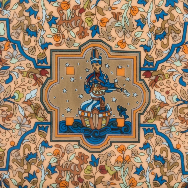 Guaranteed authentic Hermes porcelain Les Jardins d'Armenie ashtray / change tray. Depicts an exotic Armenian garden intricately displayed in blue and or (gold). A perfect accent piece for any room. Protected by velvet goatskin on the