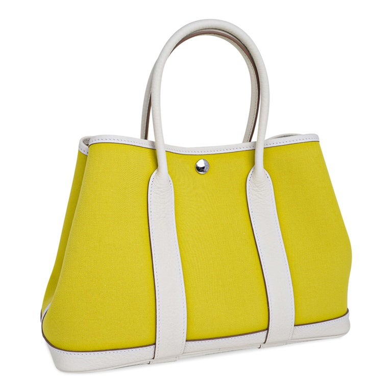 Guaranteed authentic Hermes Garden Party 30 bag featured in Lime and White Toile Officier and Vache Country leather. This crisp and fresh Garden Party 30 tote bag is the perfect about town tote.  Durable and strong toile reinforced with the leather