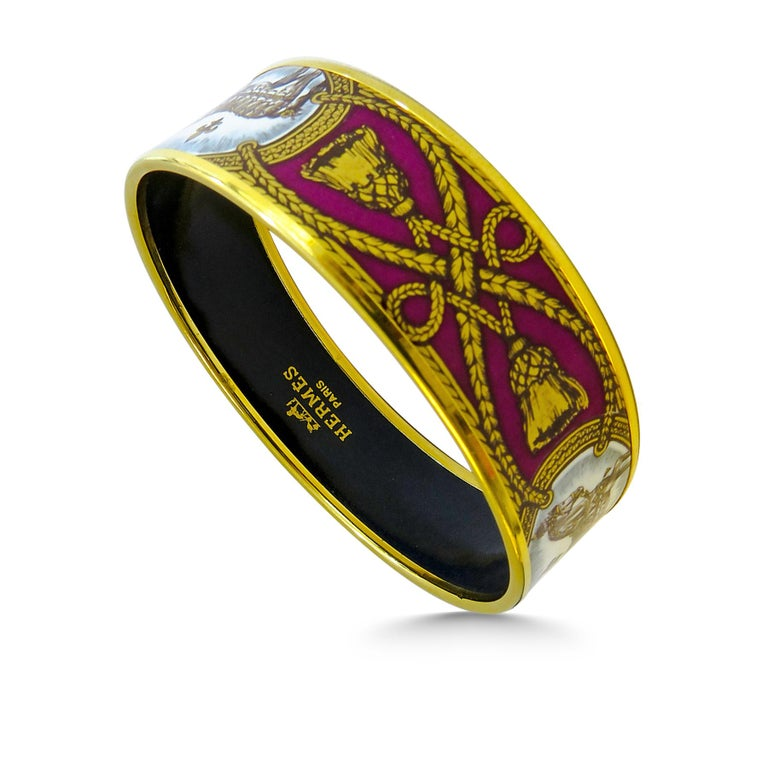This Hermes bangle features an 18 Karat gold plated with a printed horse pattern enamel. Carved in Austria, It weighs 44.5 grams, 20mm wide and has an inner diameter of 2.7 inches to give a comfortable fit in your wrist.   Condition: Excellent