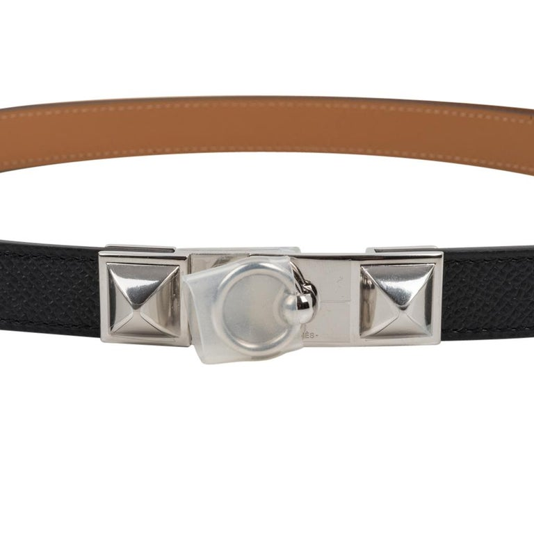 Guaranteed authentic Hermes adjustable rivale 18 belt features black epsom leather. Palladium medor hardware. Wonderful one size than fits most can be worn either at the waist or on the hip works on a sliding system. Measrues .7